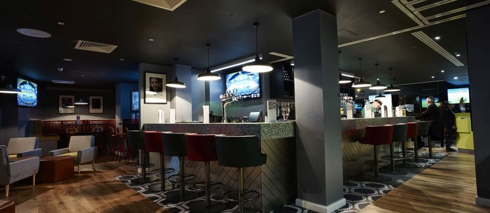Floor Tiling to Bar Area at Cafe Football In Manchester