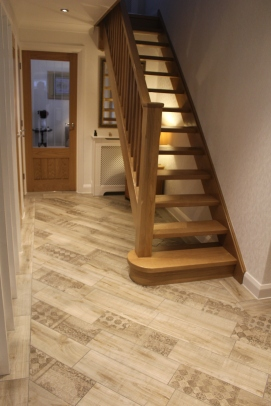 Tiling to Foot of Stairs in Laminate Effect tiles